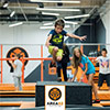 Orange black trampoline park kid jumping