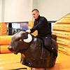 Orange black trampoline park kid on mechanical bull