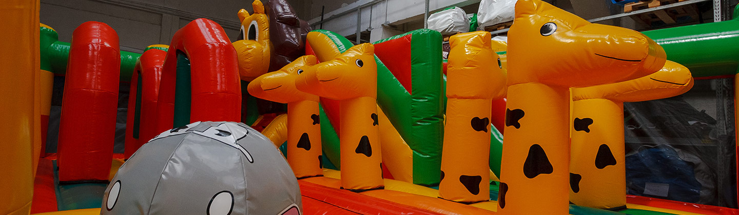 Red orange green brown animal themed inflatable park