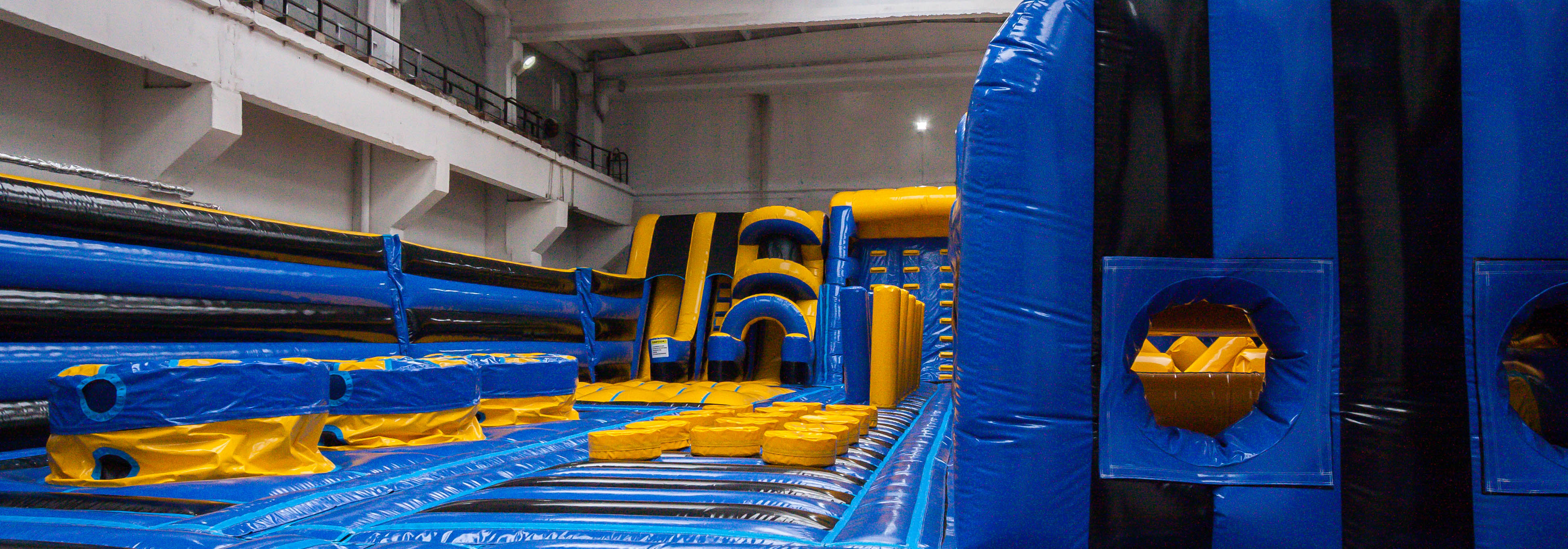 yellow blue black inflatable theme park obstacle