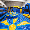 yellow blue obstacle course inflatable theme park wobbly beds