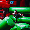 Red black green inflatable theme park slide obstacle course kid