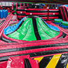 Red black green inflatable theme park slide obstacle course