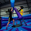 obstacles yellow and red themed Inflatazone inflatable theme park