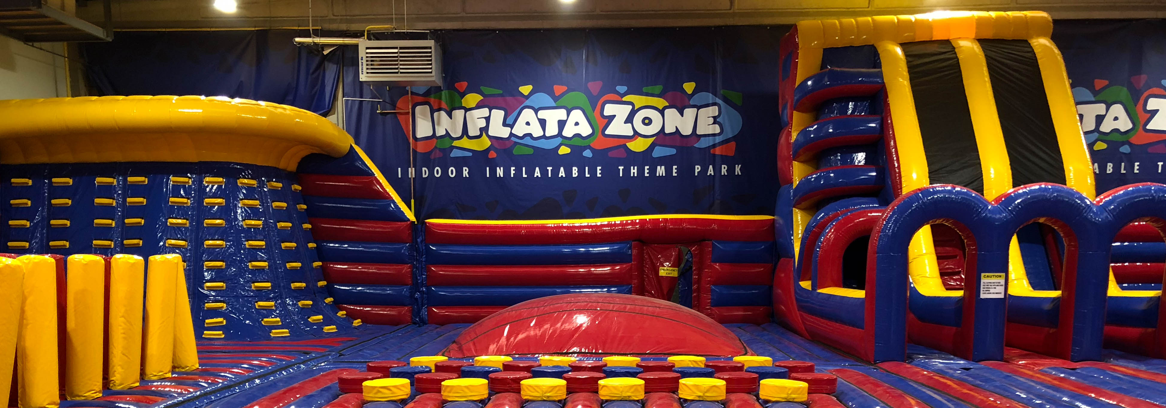 red and blue themed Inflatazone inflatable theme park