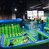 Kids jumping on green blue inflatable theme park