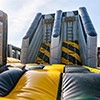 Yellow Grey black inflatable theme park obstacle course unclimbable ladder