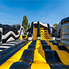 Yellow Grey black inflatable theme park obstacle course warrior wall