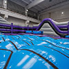 Purple blue black gray inflatable park obstacle course bubbly bed