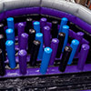 Purple blue black gray inflatable park obstacle course biff bash