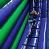 kid climbing on ladder inflatable park